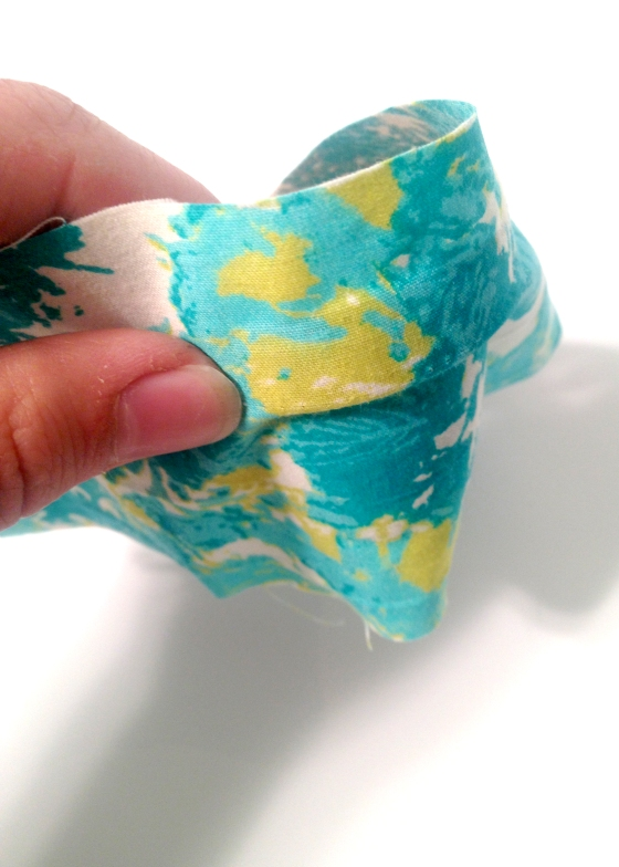 Place your fabric on the mod podge and make sure there aren't any bubbles. Continue this around the entire pot.