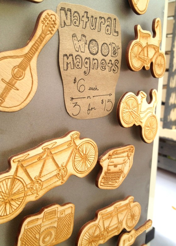 These are hand-carved wooden magnets, incredibly neat.