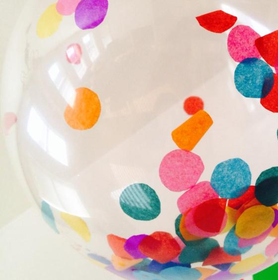I cut circles out of tissue paper and put them inside clear balloons to create confetti filled balloons.