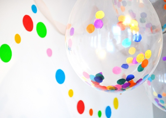 I had some confetti/sprinkle shaped garland hanging on the wall behind the balloons.