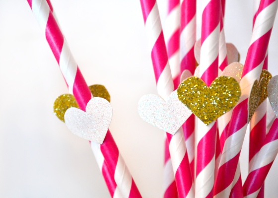 I bought some pink striped paper straws and then cut hearts out of some of white and gold glitter paper to glue on.